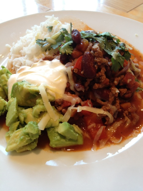 chilli con carne with avocado and sour cream